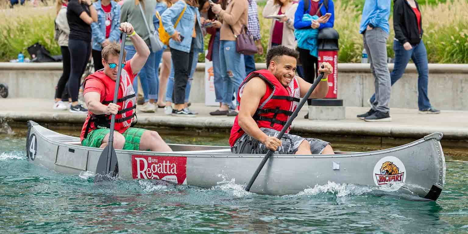 Students row in the men's division of the Regatta.