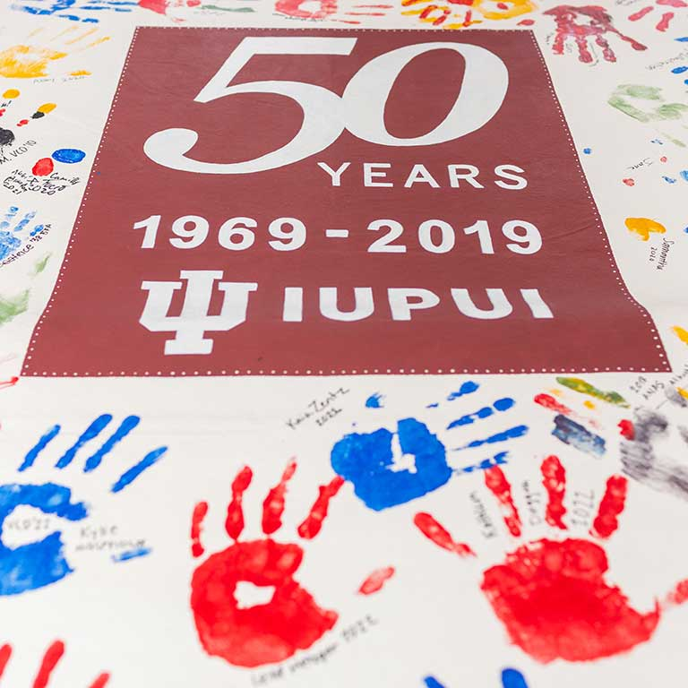 The Herron School of Art celebrates IUPUI's 50th Anniversary with a hand print and signature display.