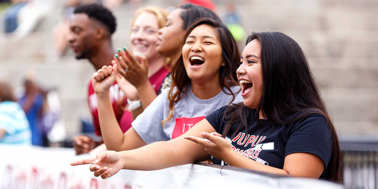 A group of student spectators cheer during the IUPUI Regatta.