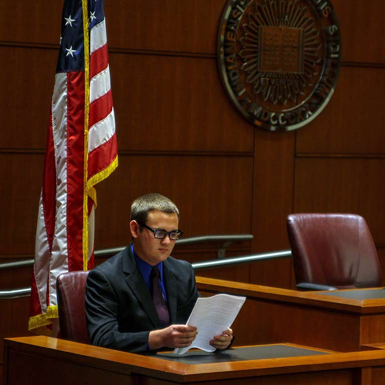 Logan Bromm sits on the bench during a mock trial.