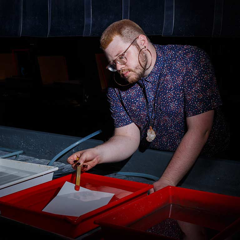 Zach Carrico uses the photography dark room in Herron School of Art.