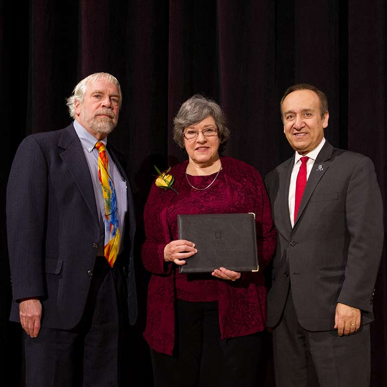 Claudia Dille with former Dean of University Library David Lewis and IUPUI Chancellor Nasser Paydar when she was honored at the 2018 Spirit of Philanthropy Luncheon.