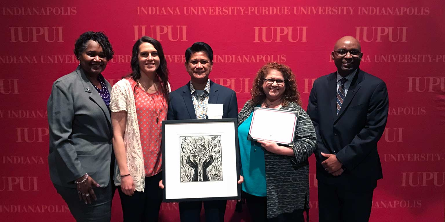 Merlin Gonzales and people from IUPUI's Division of Student Affairs while he was honored at the 2018 Spirit of Philanthropy luncheon.