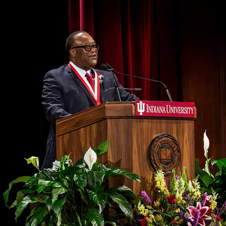 Lacy Johnson speaks at a podium as he's honored with IU's Distinguished Alumni Service Award.