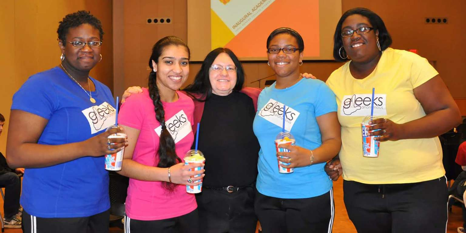 Taylor Rhodes with her sisters, a friend and former Dean of University College Jane Luzar at an Academic Bowl event.