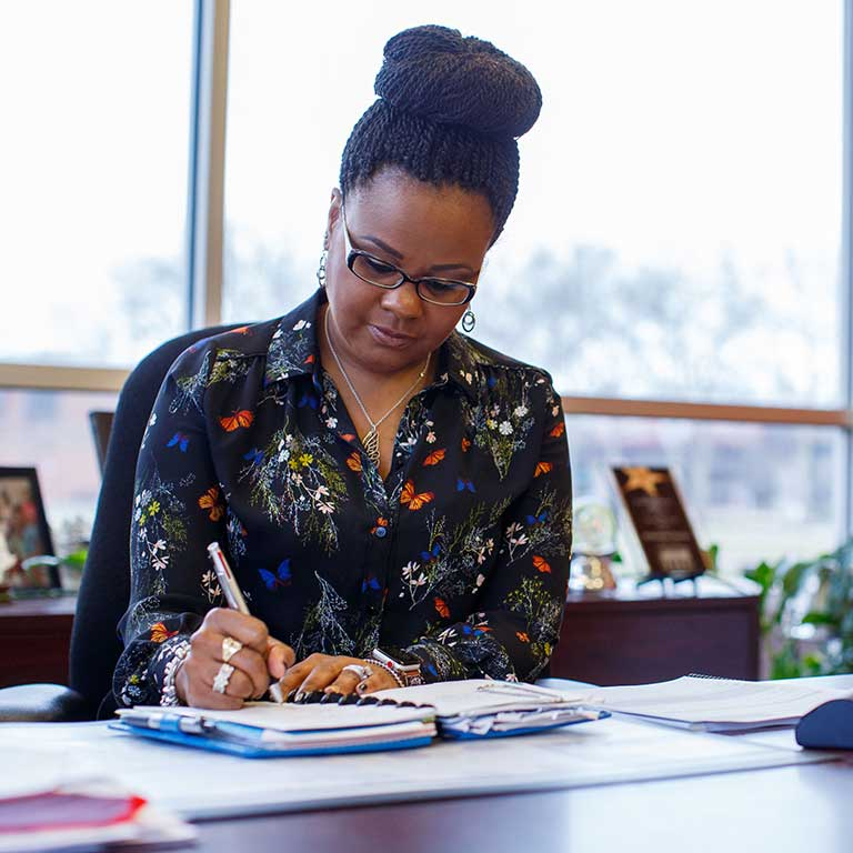 Khalilah Shabazz works at her desk.
