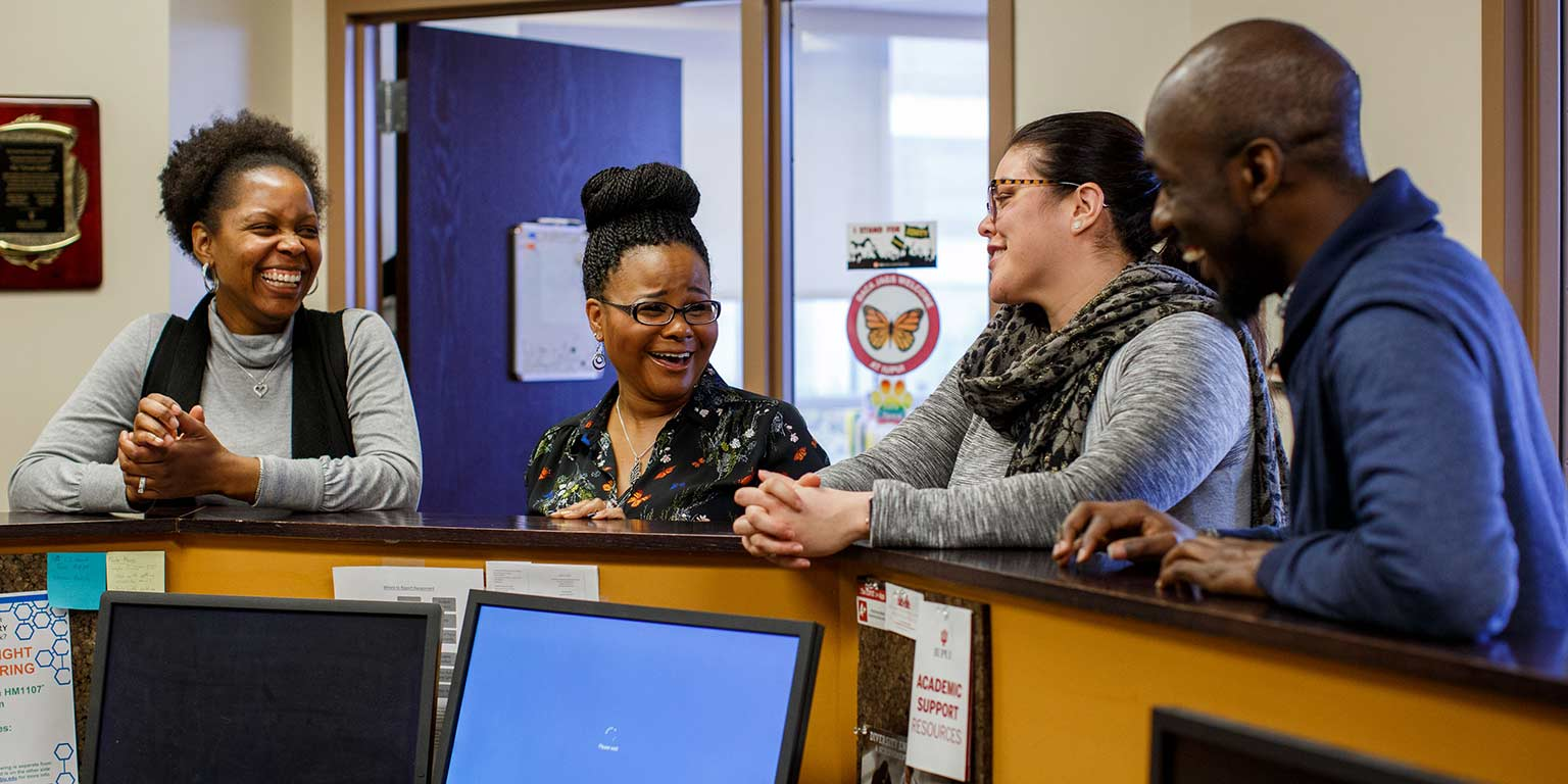 Khalilah Shabazz chats with colleagues at the Multicultural Center.