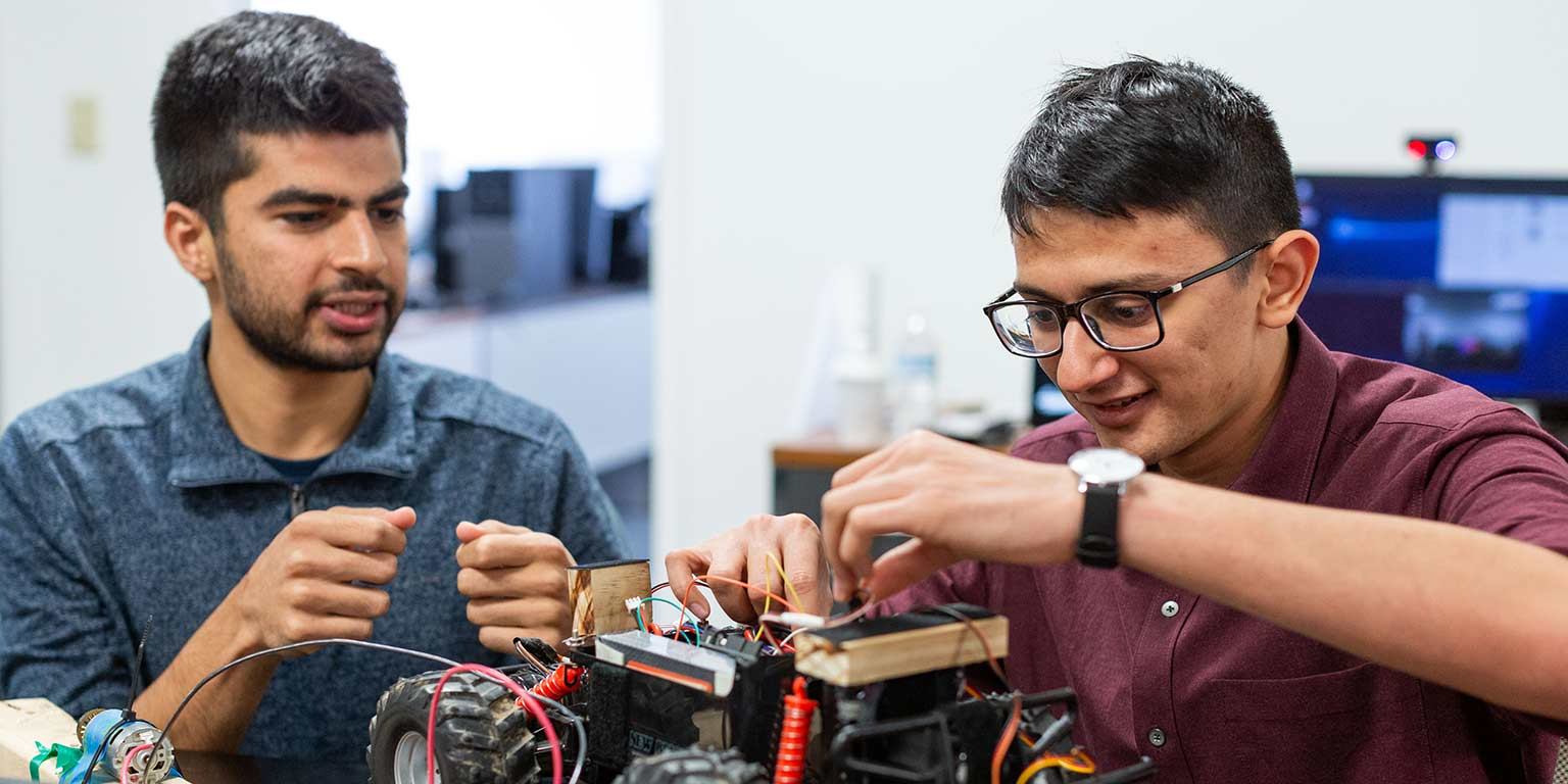 Sohin works on a prototype with a classmate.