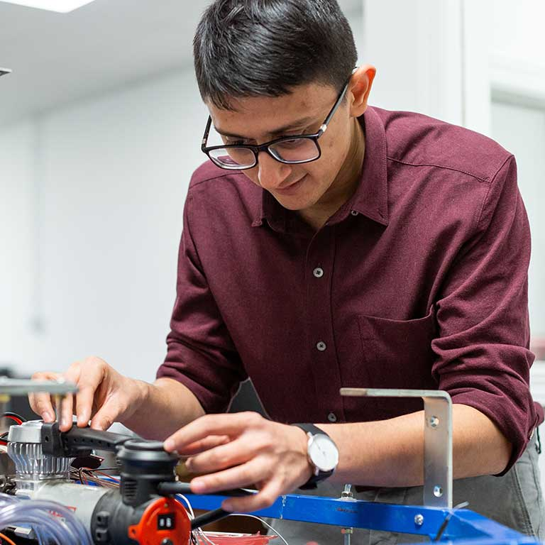 Sohin Shah works on a autonomous vehicle he helped develop.