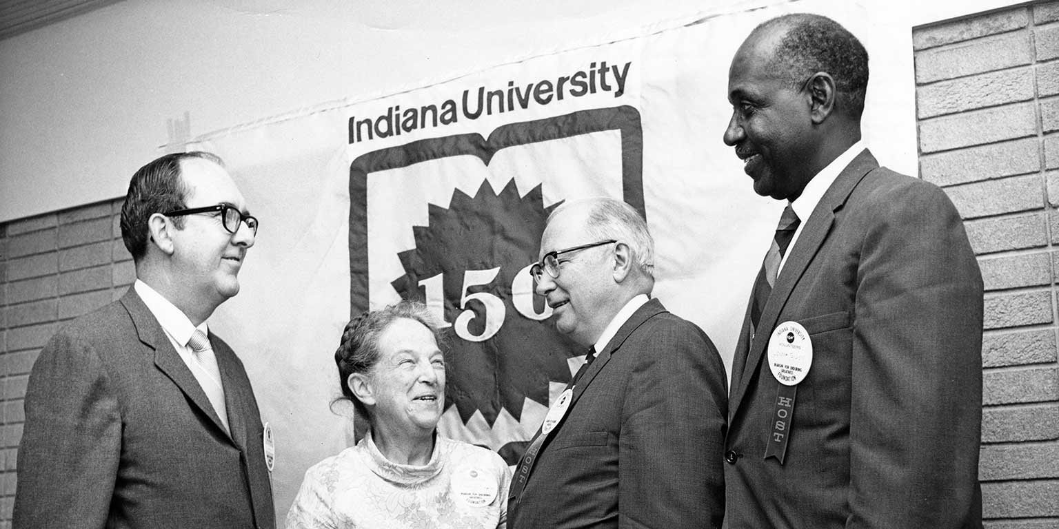 Former IUPUI Chancellor Glenn Irwin, Former Assistant Dean of the School of Nursing Frances Orgain, former IUPUI Chancellor Maynard Hine, and Joseph Taylor at the School of Nursing Symposium in 1970.