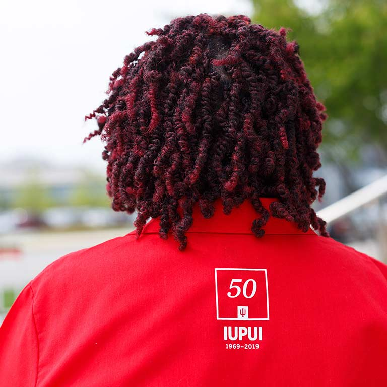 The back of Wilhelmenia's work shirt with the IUPUI 50th Anniversary logo.