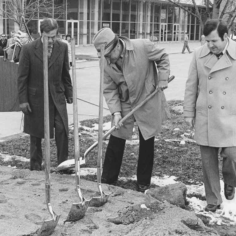 Dignitaries break ground on the Taylor Courtyard on a cold winter day. Black and white photo.